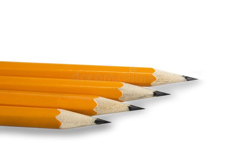 Lápices amarillos con el borrador en el fondo blanco imágenes de archivo libres de regalías