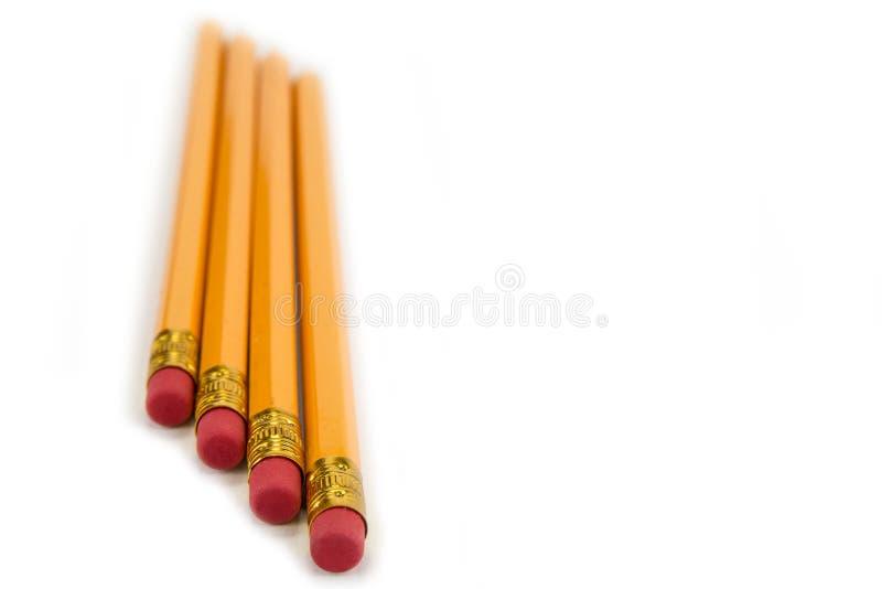 Lápices amarillos con el borrador en el fondo blanco imagen de archivo libre de regalías