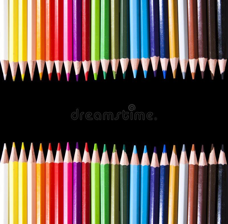 Lápices coloreados en negro imágenes de archivo libres de regalías