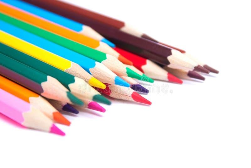 Lápices coloreados en un fondo aislado imagen de archivo