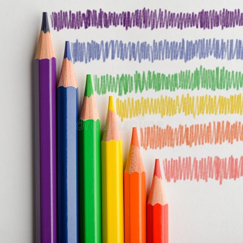 Lápices coloreados y arco iris de LGBT imagen de archivo libre de regalías