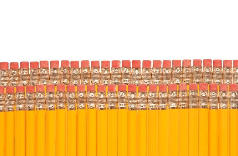 Lápices con los borradores foto de archivo