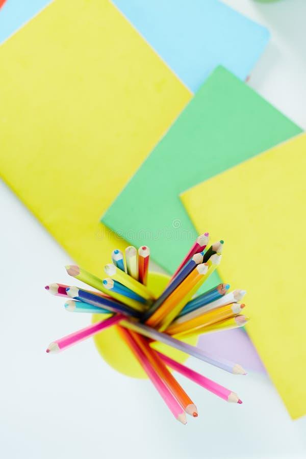 Lápices y copybooks fotografía de archivo libre de regalías
