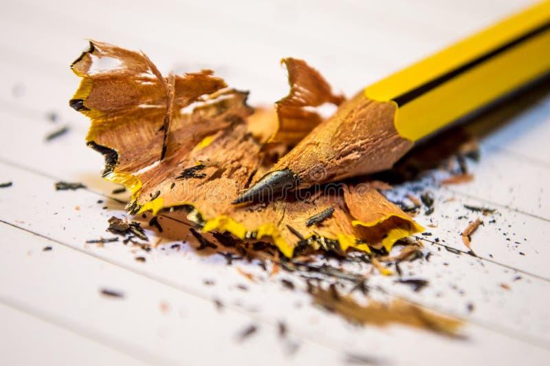 Lápis Amarelo Acima do Livro Branco em Macro Fotografia fotografia de stock