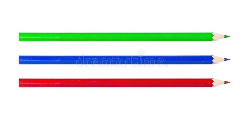 Lápis azul e vermelho verde isolado no fundo branco fotos de stock royalty free