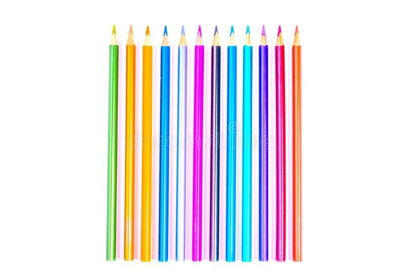 Lápis brancos, coloridos bonitos ajustados do lápis coloridos no fundo branco Logo ? escola De volta ? escola fotografia de stock royalty free