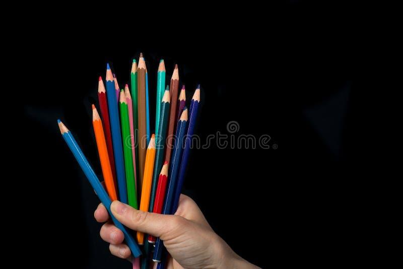 Lápis coloridos handheld imagem de stock