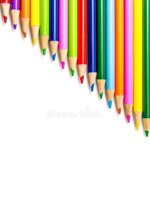 Lápis coloridos nas fileiras fotografia de stock royalty free