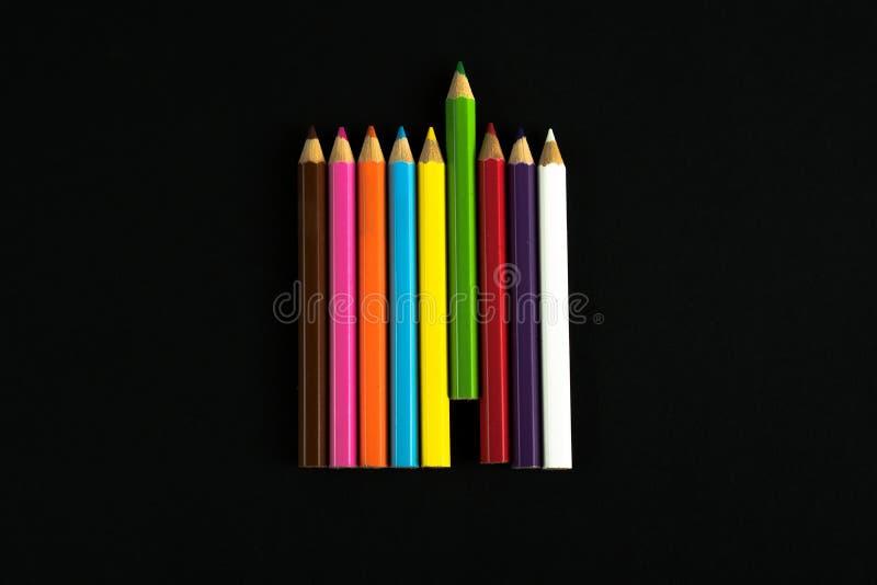 Lápis coloridos que formam um detalhe da união imagem de stock