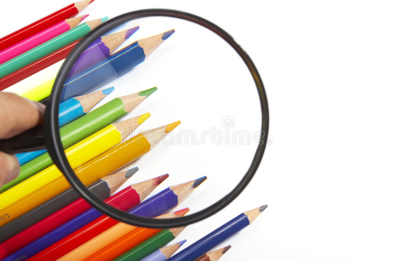 Lápis da cor, magnifier fotografia de stock