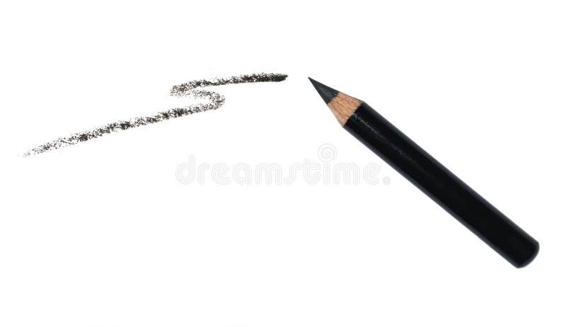 Lápis de olho preto e uma mancha de um lápis isolado no fundo branco Produto cosmético fotos de stock