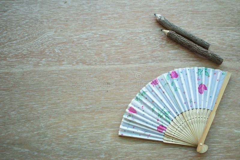 Lápis do fã e da madeira de China imagem de stock royalty free