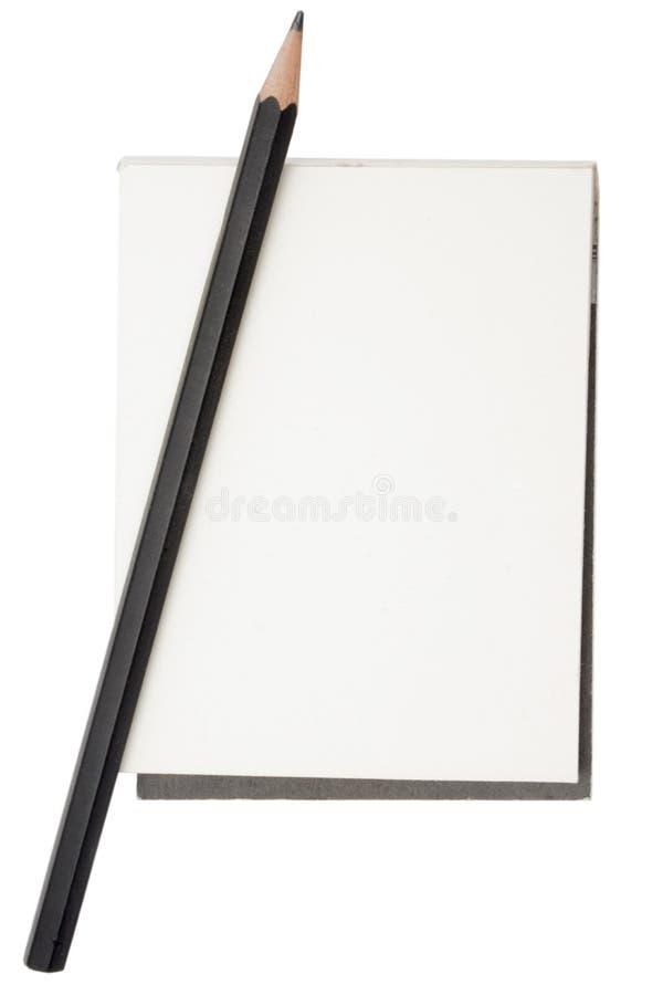 Lápis e bloco de notas imagens de stock