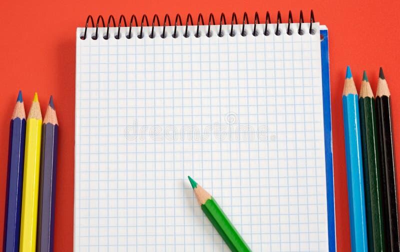Lápis e caderno fotografia de stock