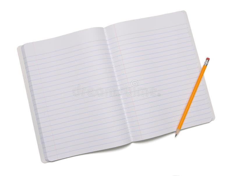 Lápis e caderno em branco fotografia de stock royalty free