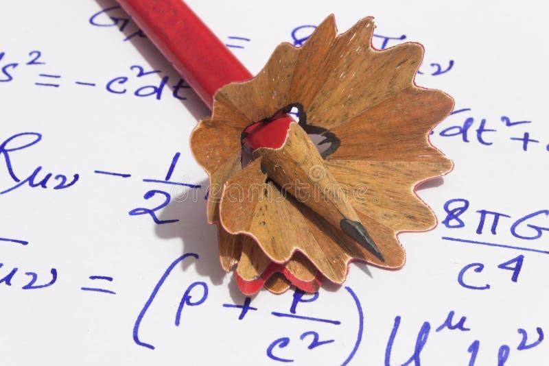 Lápis e rapagem no papel foto de stock royalty free