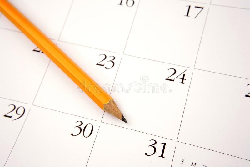 Lápis no calendário imagem de stock royalty free