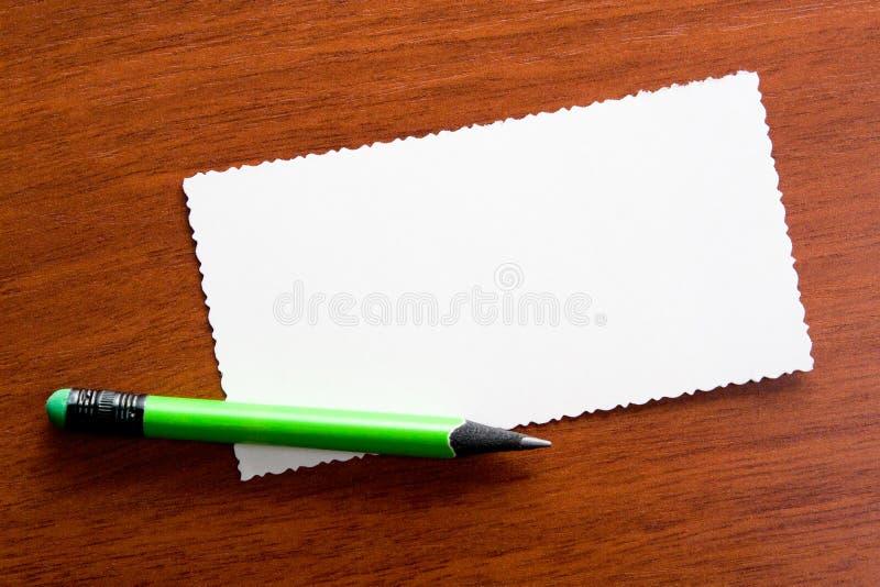 Lápis no close up do memorando imagem de stock royalty free