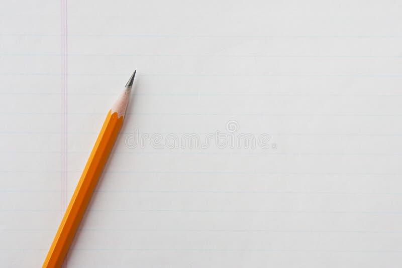 Lápis no papel do caderno fotos de stock