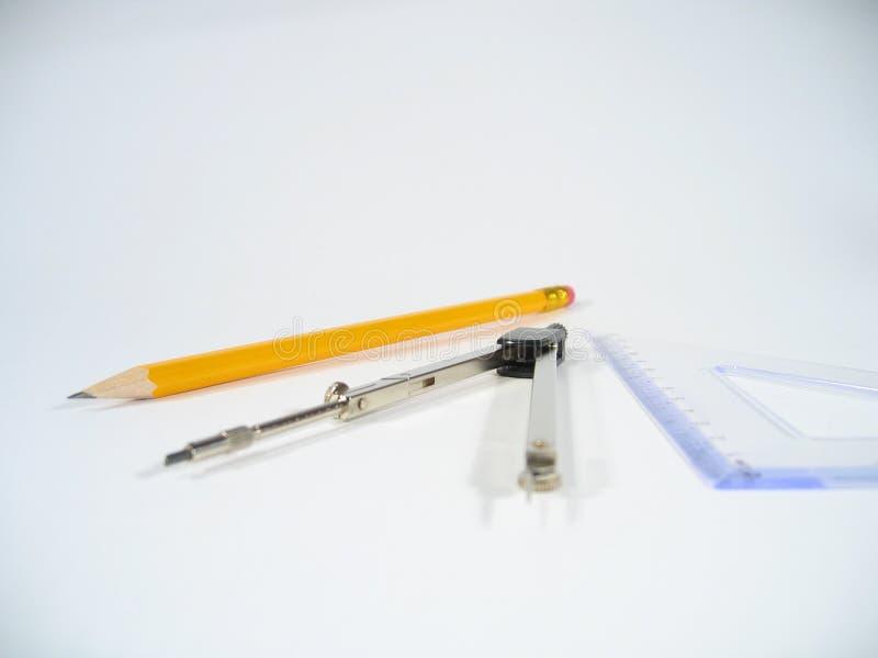 Lápis, pares de compassos e quadrado ajustado foto de stock royalty free