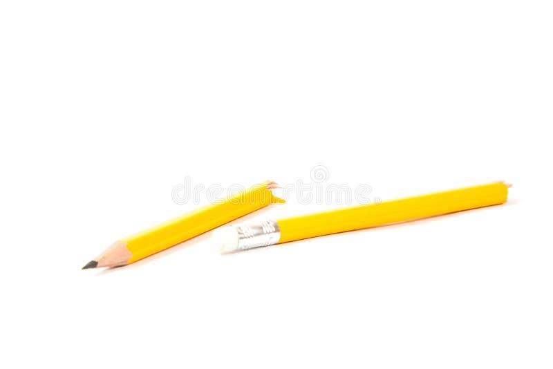 Lápis quebrado no fundo branco fotografia de stock royalty free
