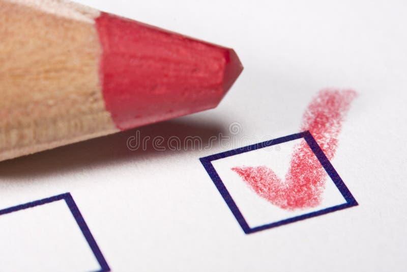 Lápis vermelho - verific fotografia de stock royalty free