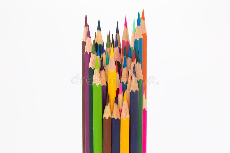 Lápiz de madera del color mezclado en blanco imagenes de archivo