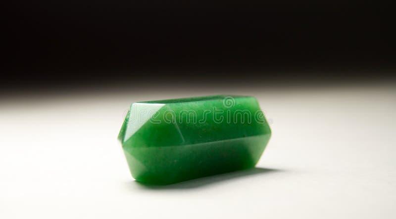 Lápiz del jade en fondo ligero fotografía de archivo