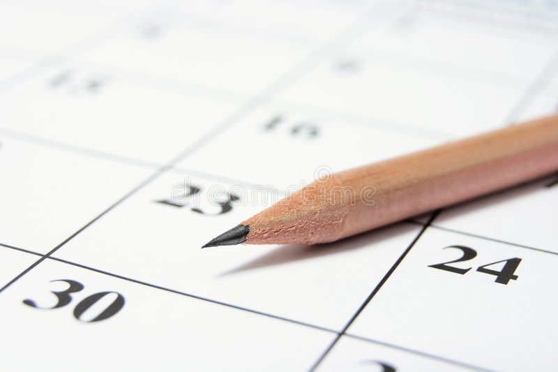 Lápiz en calendario imagenes de archivo