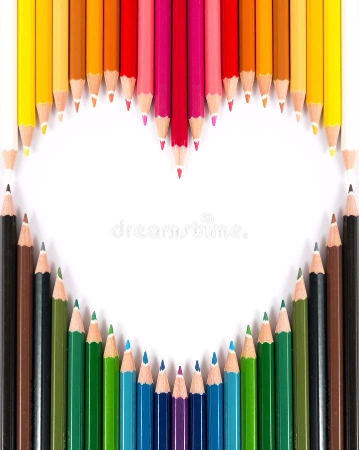 Lápiz en colores pastel colorido en dimensión de una variable del corazón imagen de archivo libre de regalías