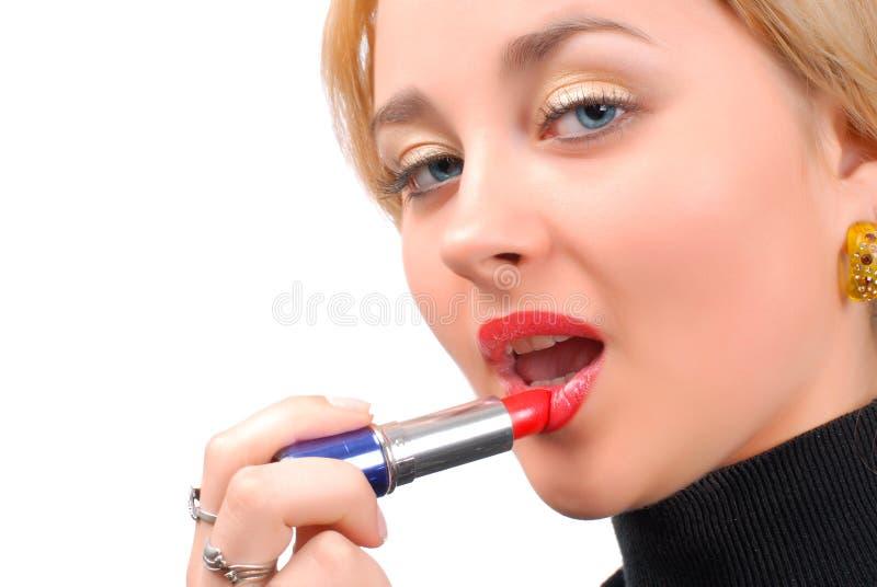 Lápiz labial rojo y labios rojos imagen de archivo libre de regalías