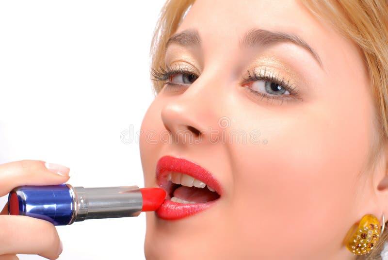 Lápiz labial rojo y labios rojos imagen de archivo