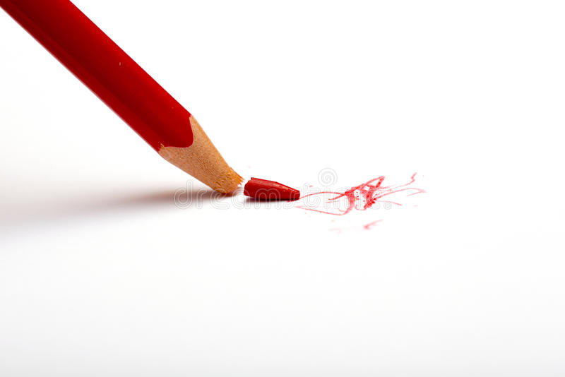 Lápiz rojo quebrado fotografía de archivo libre de regalías