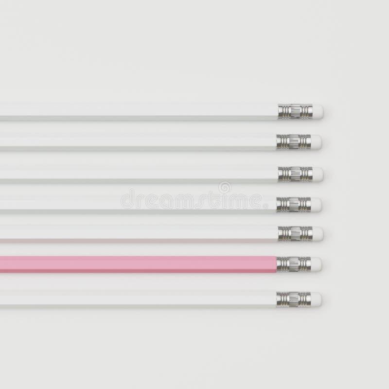Lápiz rosado excepcional y lápiz blanco en el fondo blanco fotografía de archivo libre de regalías