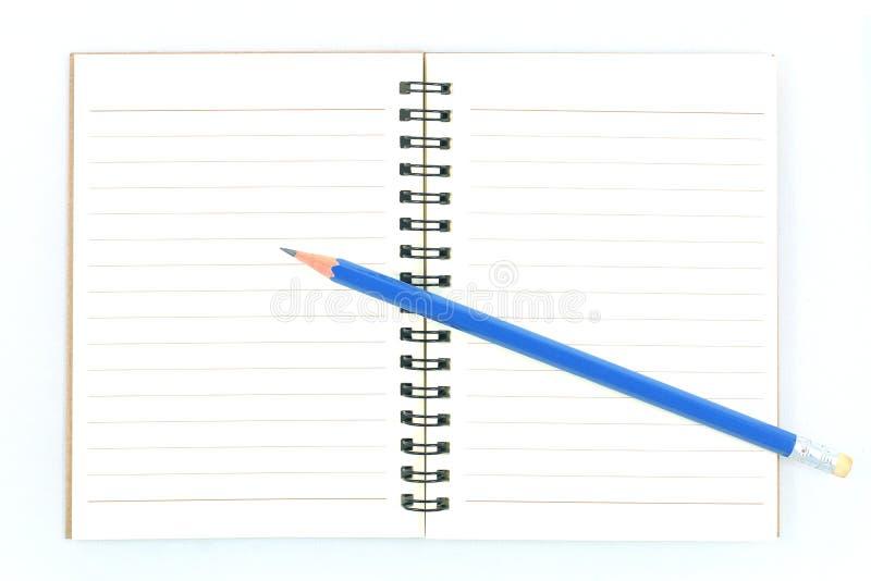 Lápiz y cuaderno fotos de archivo