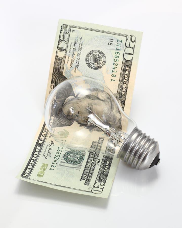 Lâmpada e dinheiro imagens de stock royalty free