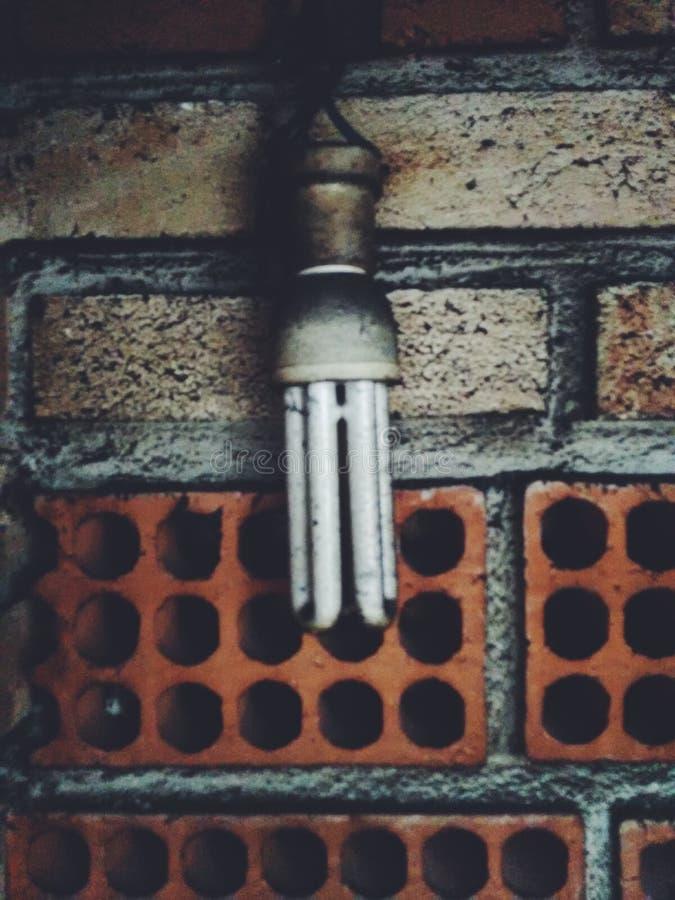 Lâmpada na parede da argila imagens de stock