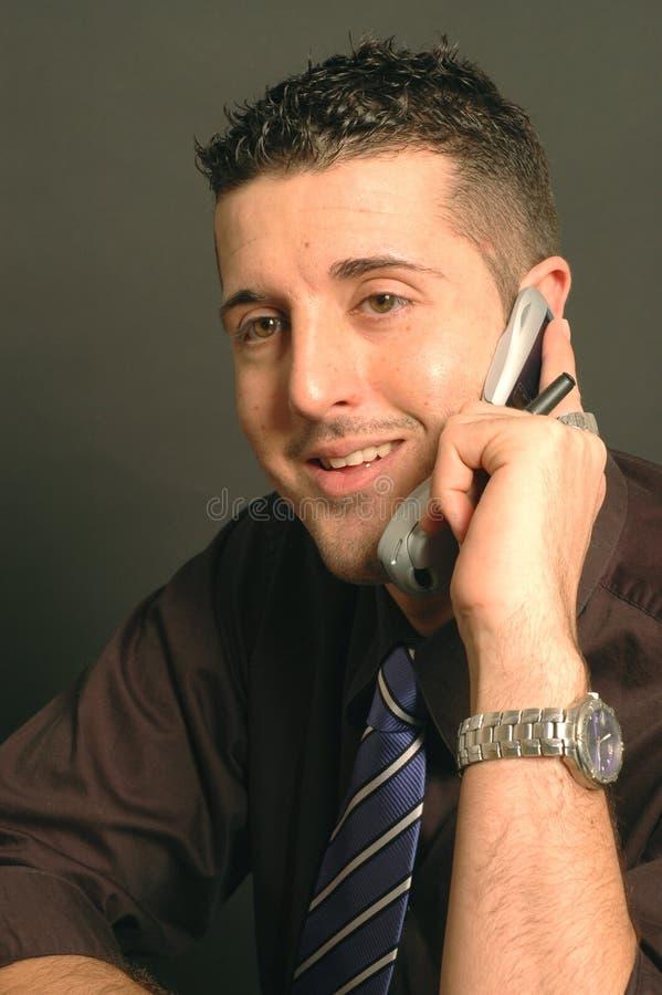 Lächeln am Telefon lizenzfreie stockbilder