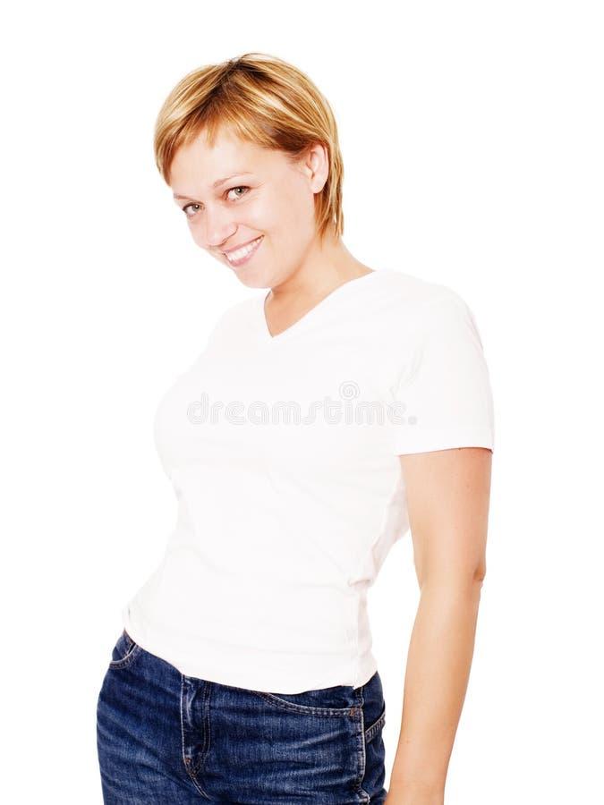 Lächelnde blonde Frau über weißem Hintergrund stockbild
