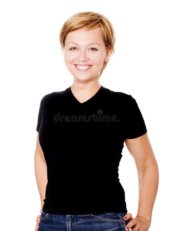 Lächelnde blonde Frau über weißem Hintergrund stockfotos