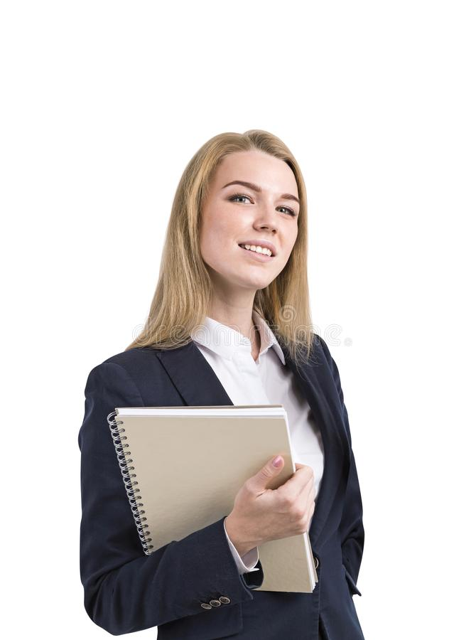 Lächelnde blonde Geschäftsfrau, Notizbuch, lokalisiert stockbild