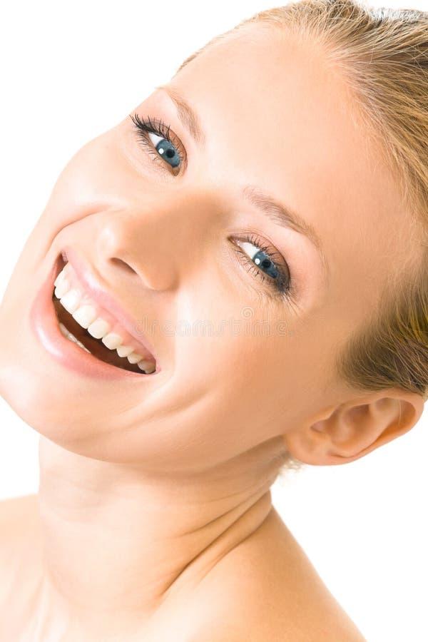 Lächelnde Frau, getrennt auf Weiß stockfotografie