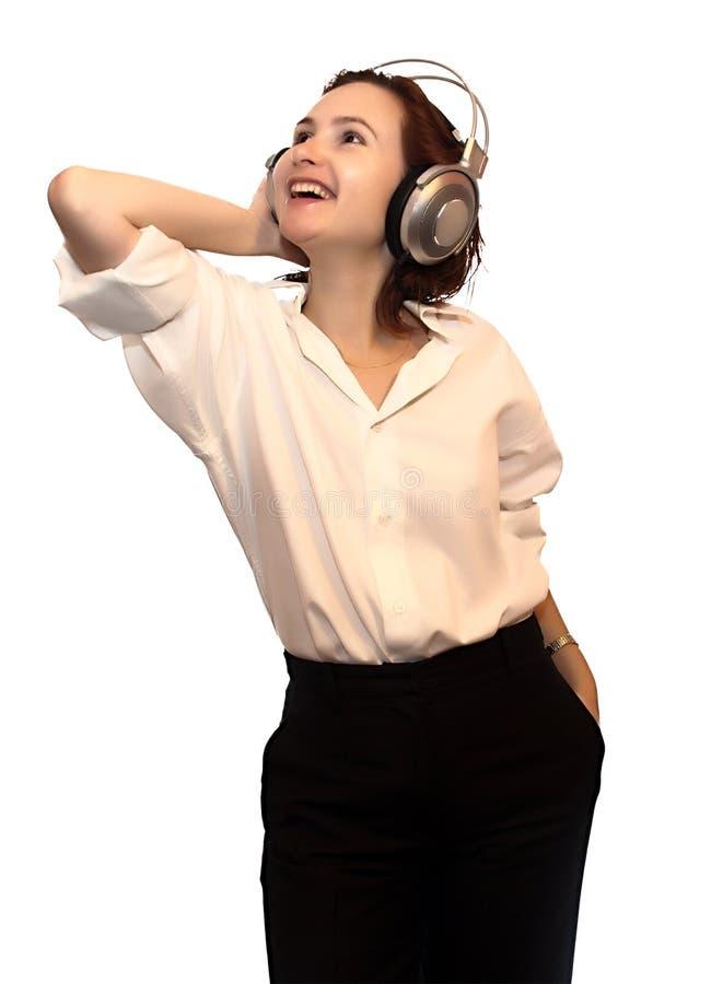 Lächelnde Geschäftsfrau in den Kopfhörern lizenzfreie stockbilder