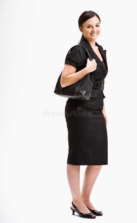 Lächelnde Geschäftsfrau in der Klage stockfotografie