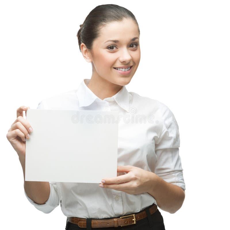 Lächelnde Geschäftsfrau, die Zeichen anhält stockfotos