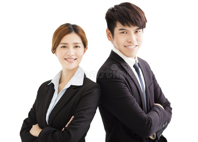 Lächelnde Geschäftsfrau und Geschäftsmann mit den gekreuzten Armen stockbilder