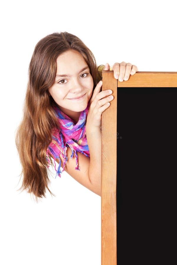 Lächelnde Jugendlichholdingtafel über Weiß lizenzfreie stockfotos