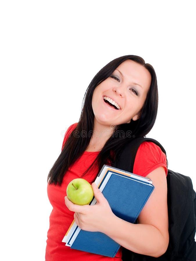Lächelnde Kursteilnehmerfrau mit Rucksack und b stockbild
