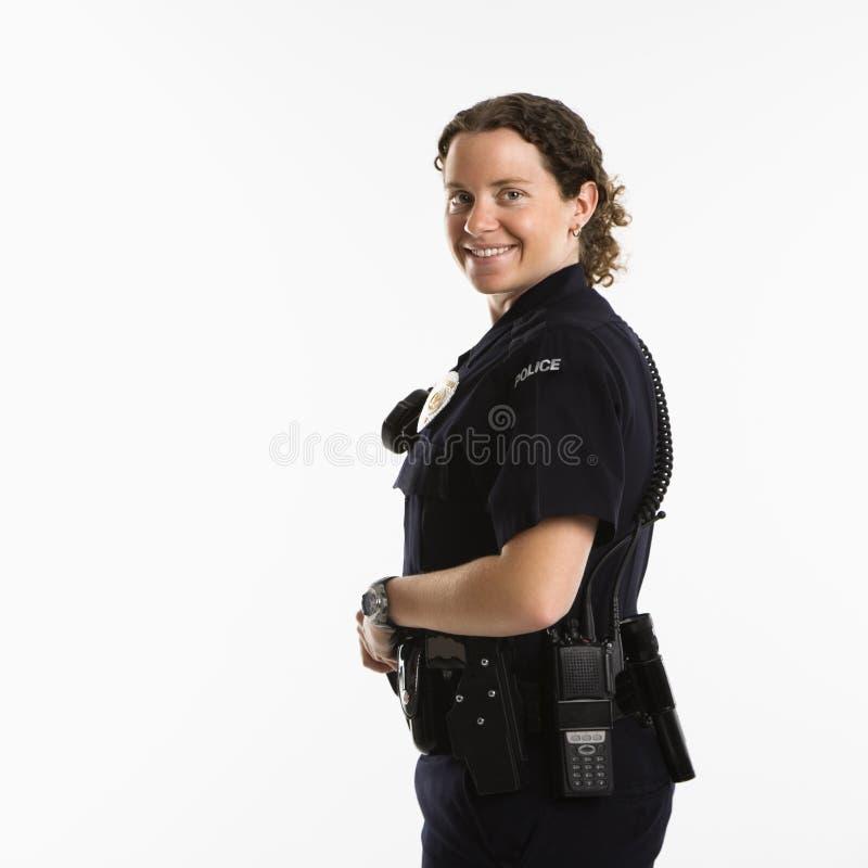 Lächelnde Polizeibeamtin. lizenzfreie stockfotos