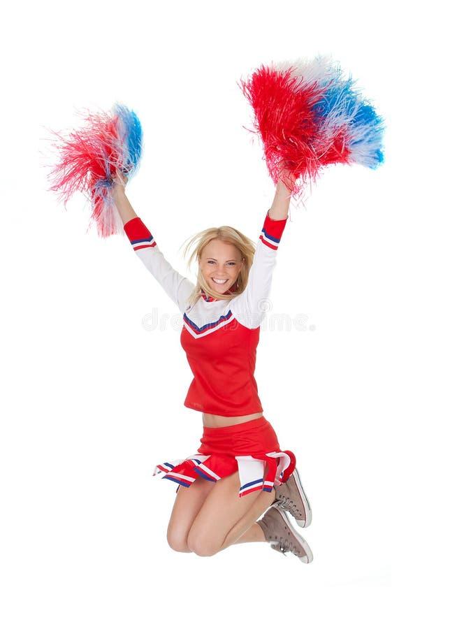 Lächelnde schöne Cheerleader mit Pompoms. lizenzfreies stockfoto